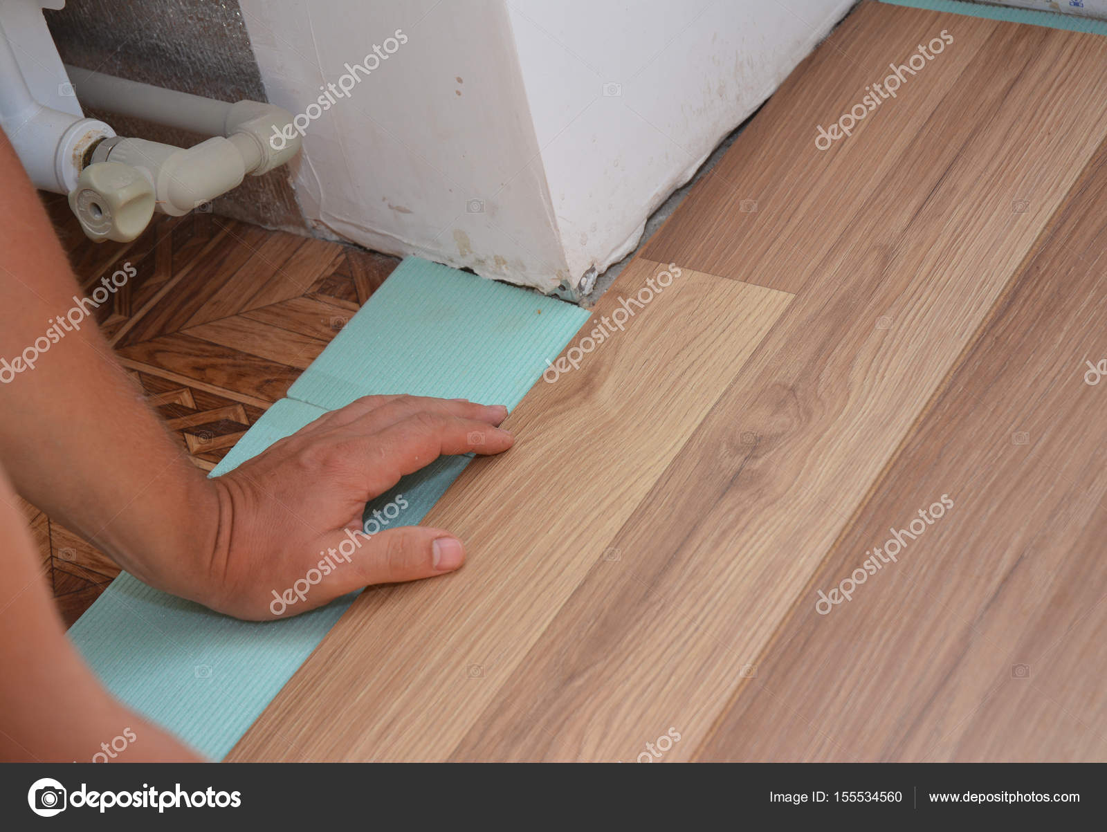 Worker Installing Wooden Laminate Flooring Handyman Laying Down Boards While Renovating A House Photo By Thefutureis