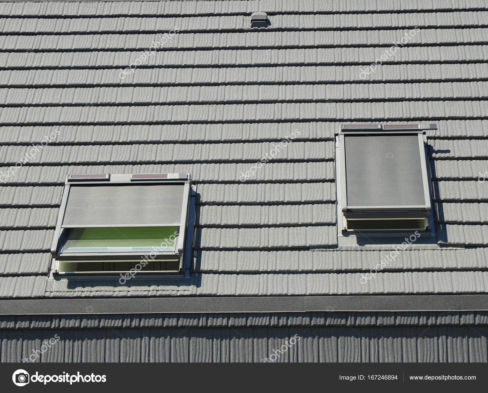 Attic Skylights With Shutters And Small Solar Panels House