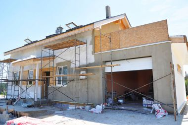 KIEV - UKRAINE  SEPTEMBER - 3, 2017: Unfinished house. Remodeling Home. House Renovation. Painting house wall and stucco, plastering wall.
