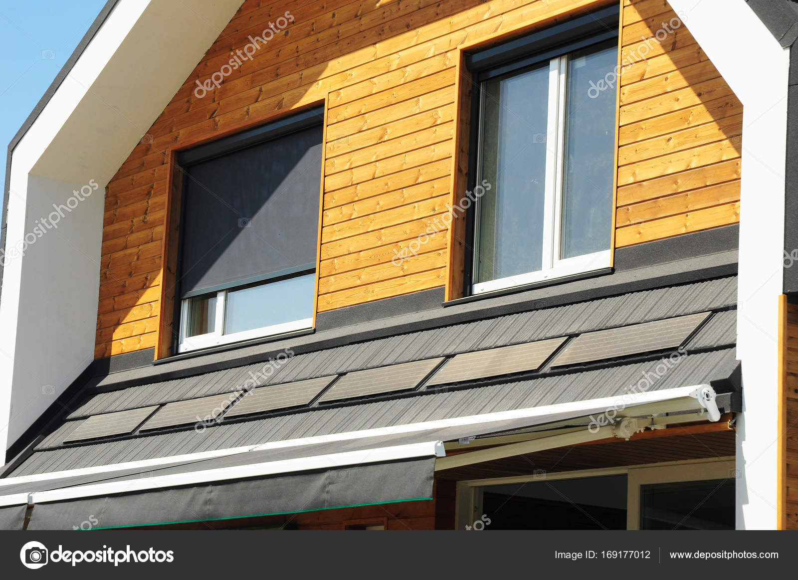 close up on house blinds sun protection exterior with solar panels