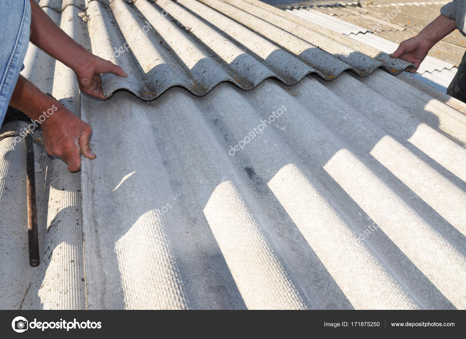Roofers replace damaged asbestos tile. Repair asbestos roof. — Stock ...