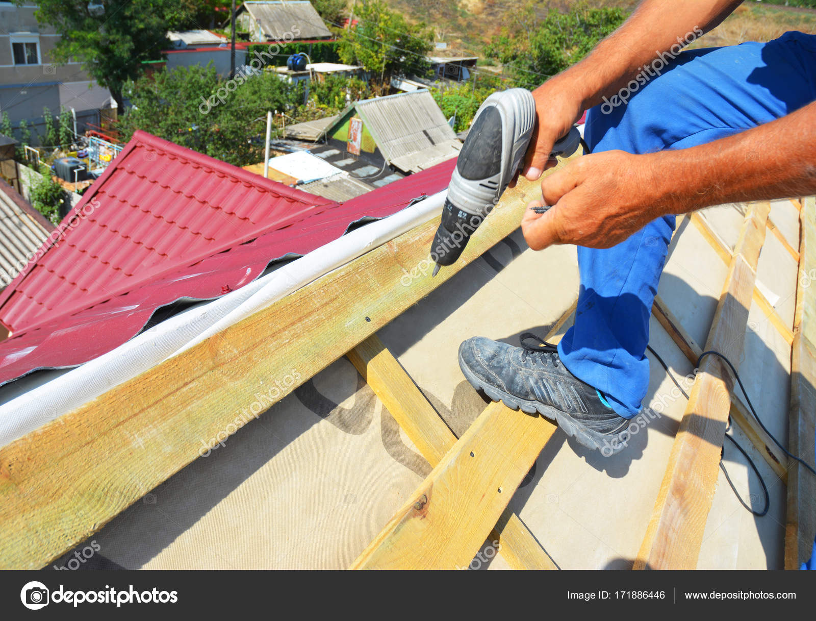 Roofing contractor installing metal roof tile for roof repair after roofing contractor installing metal roof tile for roof repair after hurricane damage roofer repair roof ppazfo