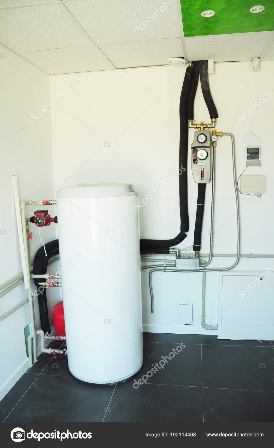 Boiler room with solar water heater tank for house energy efficiency ...