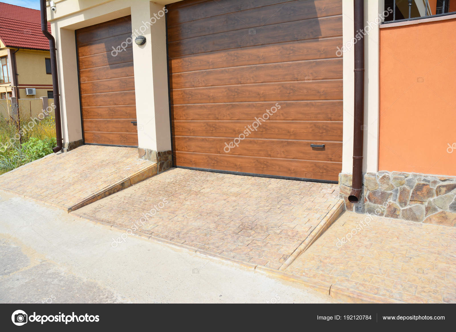 modern garage doors. Modern Garage Doors For Two Cars With Pathway And Plastic Gutter Pipe \u2014 Stock Photo