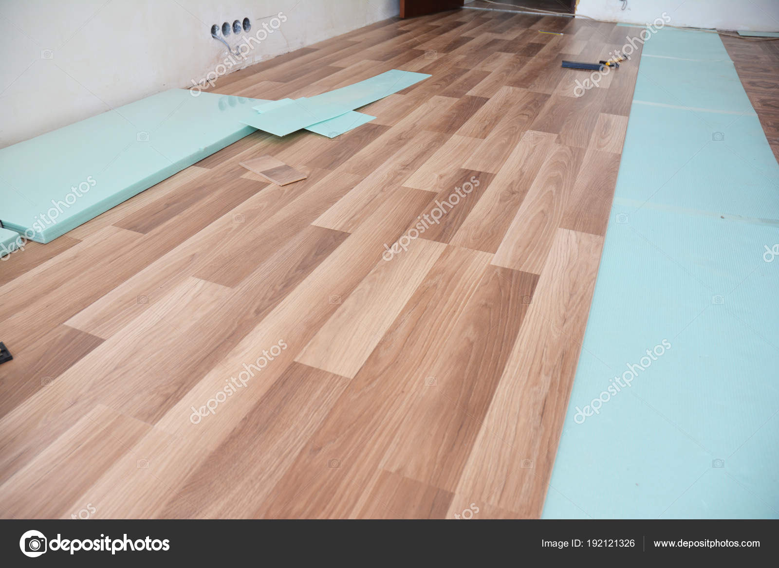 Installing Wooden Laminate Flooring With Insulation And Soundproofing Sheets Stock Photo