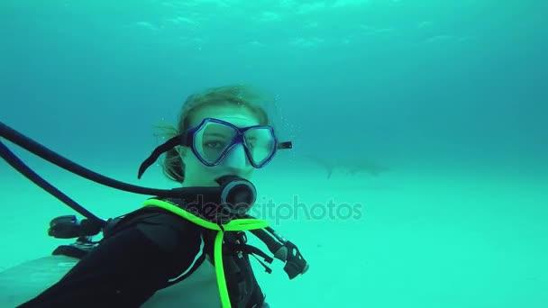 Diver girl shoot herself with floating shark underwater. Ocean wildlife. Extreme
