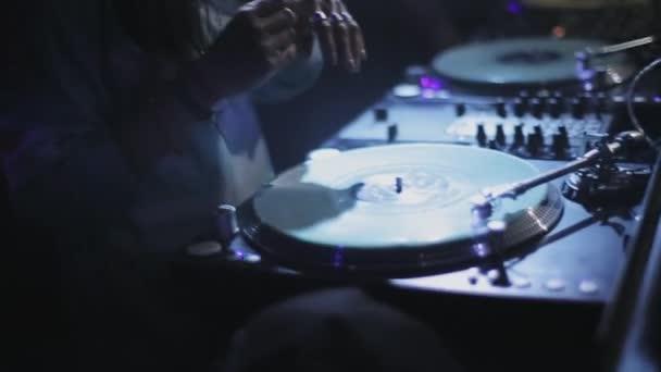 SOCHI, RUSSIA - APRIL 4, 2016: Dj girl spinning at turntable on party in nightclub. Spotlights. Nightlife.