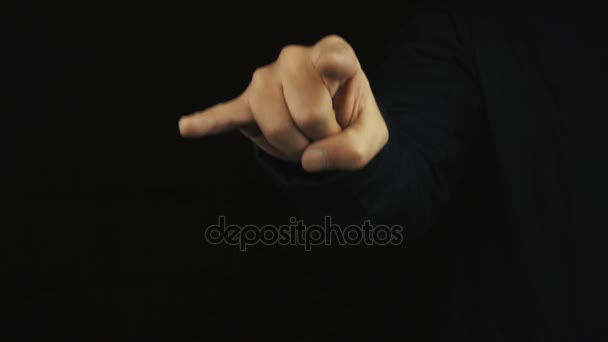 Male hand in long sleeve jacket make pointing bull sign of the horns gesture