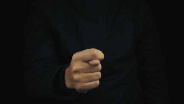 Male hand in long sleeve jacket making obscene shysh sign gesture