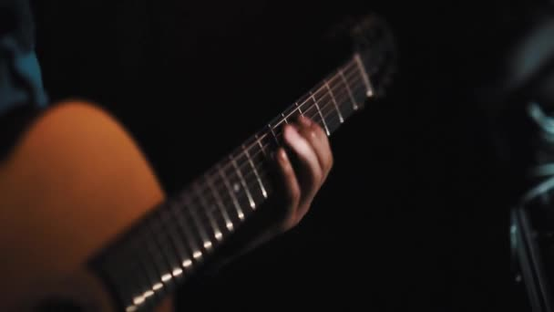 Man hand playing acoustic guitar, fast finger change chords