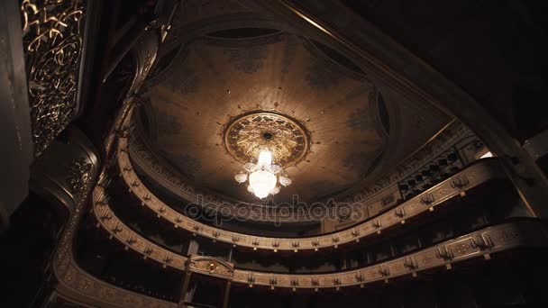 expensive chandelier warm light in luxurious concert hall stock