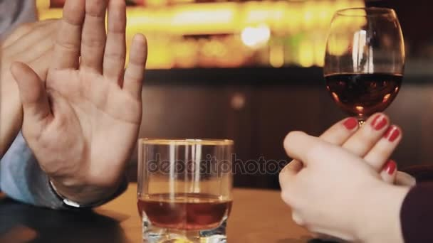 Hands of couple on date arguing over alcohol drinks — Stock Video © bazava  #162276962
