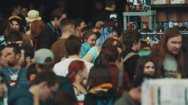 SAINT PETERSBURG, RUSSIA - MAY 20, 2017: Young people crowd movement at indoors media culture festival
