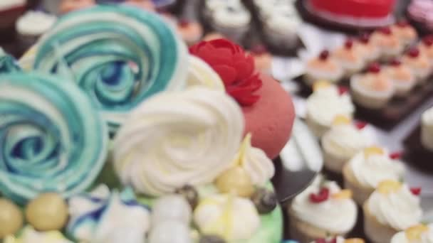 Beatifully decorated desserts, colorful cakes and muffis