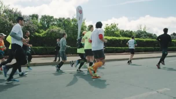 Crowd of different people athlets running marathon in colorful c