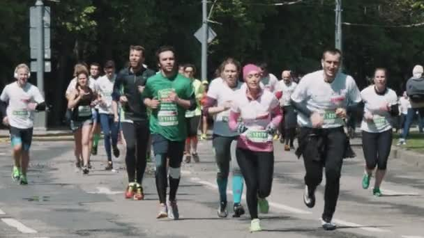 Marathon charity crowd of healthy people in sportive clothes