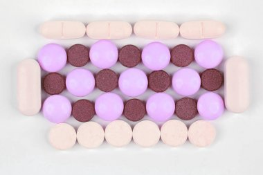 different medicinal pills on white background