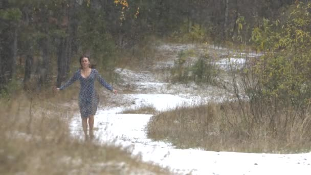 The girl in the forest and the first snow.