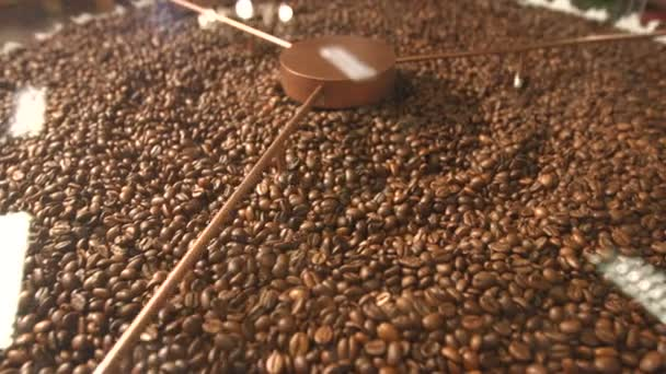 Processing of coffee beans.Horizontal ( from left to right ) pan. Fried coffee beans are mixed.