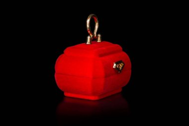 Red jewelry boxes isolated on black background. Retro vintage style.
