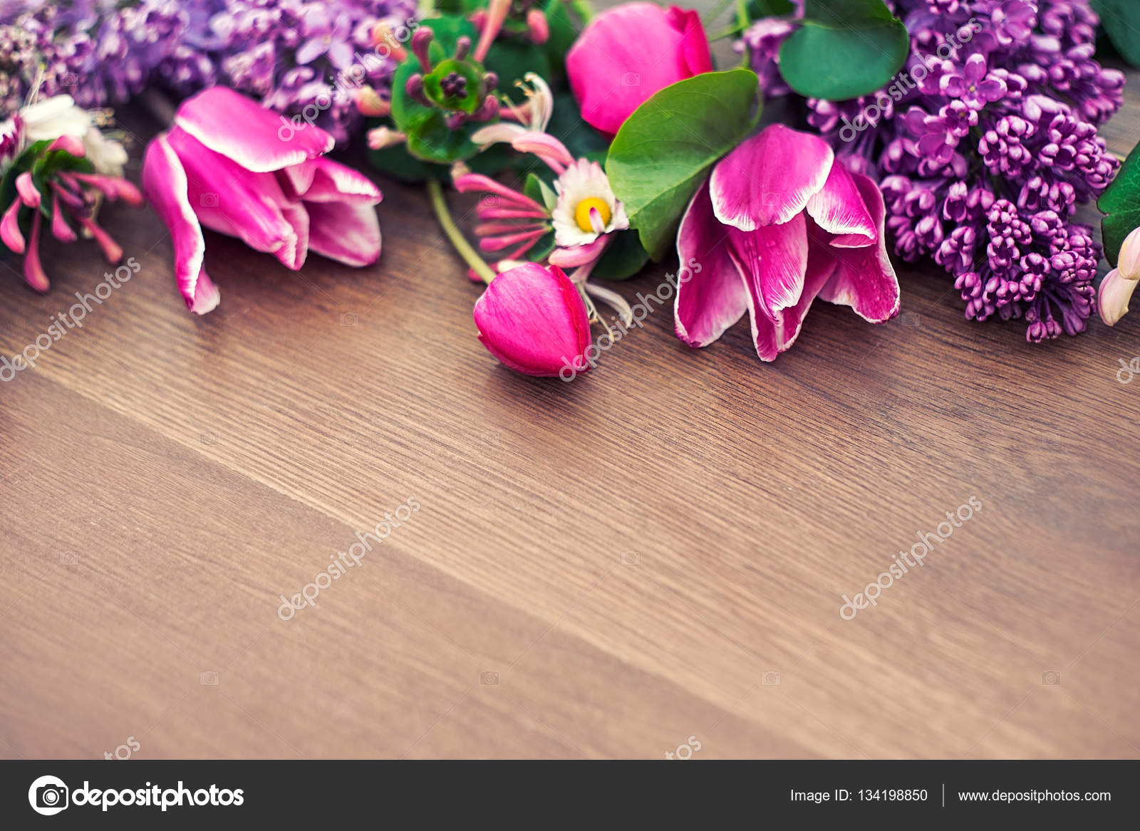 Beautiful Flowers Lying On A Wooden Background A Spring Gift To