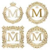 Fotografia Monogrammi dellannata di lettera dorata M impostato. Stemmi araldici, cornici rotonde e quadrate