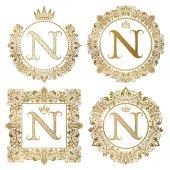Fotografia Monogrammi dellannata di lettera dorata N impostare. Stemmi araldici, cornici rotonde e quadrate