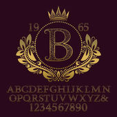 Golden ornate letters and numbers with initial monogram in coat of arms form.