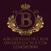 Arany díszes betűk és számok a kezdeti monogram formában címer