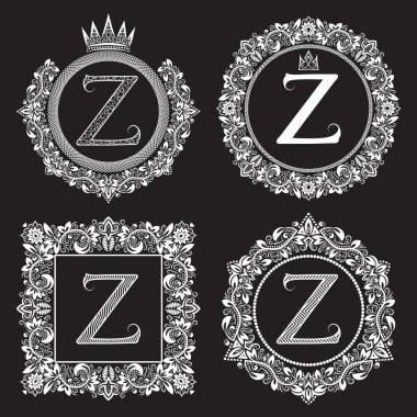 Vintage monograms set of Z letter. Heraldic coats of arms in wreaths, round and square frames. White symbols on black.
