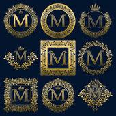 Fotografia Set di monogrammi dellannata della lettera M. Logo dorati araldici in corone, cornici rotonde e quadrate
