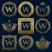 Fotografia Set di monogrammi dellannata della lettera W. Logo dorati araldici in corone, cornici rotonde e quadrate