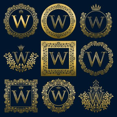 Vintage monograms set of W letter. Golden heraldic logos in wreaths, round and square frames.