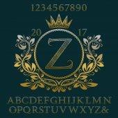 Arany hullámos mintás betűk és számok a kezdeti monogram címer formában. Elegáns betűkészlet és elemek készlet logo tervezés.