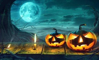 Halloween Pumpkin in Dark Forest. Halloween Background.