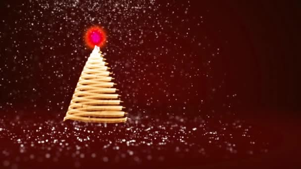 Red Christmas tree from glow shiny particles on the left. Winter theme for Xmas or New Year background with copy space. 3d Xmas tree V8 with snow DOF