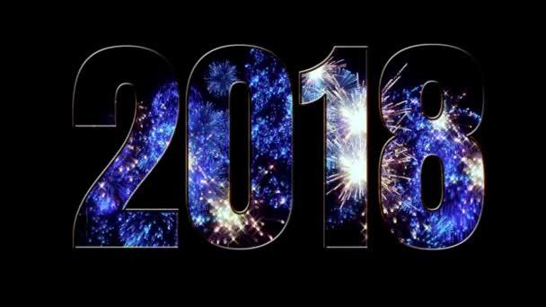 Složení nového roku 2018. Nádherný modrý ohňostroj prostřednictvím nápis 2018. Světlé ohňostroje, úžasné světelnou show. V4