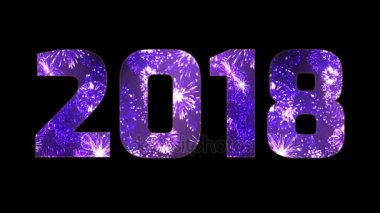 beautiful purple fireworks through the inscription 2018. Composition for the new 2018 year. Bright fireworks, amazing light show. Many pyrotechnic volleys. V4