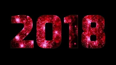 beautiful red fireworks through the inscription 2018. Composition for the new 2018 year. Bright fireworks, amazing light show. Many pyrotechnic volleys. V4