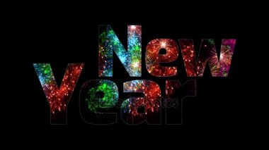 beautiful multi colored fireworks glow through the text Happy New Year. Composition for the new year celebration. Bright fireworks, amazing light show. V12