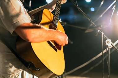 Man playing yellowe an acoustic guitar with nylon strings closeup . Music background