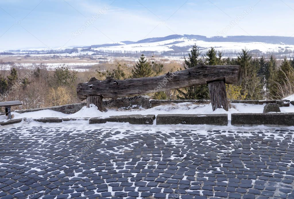Empty ancient wooden bench on mountain.