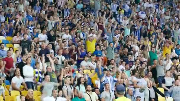 Kiev, Ukraine, July 2017: Spectators football match at the stadium exult after a goal scored. Premier league