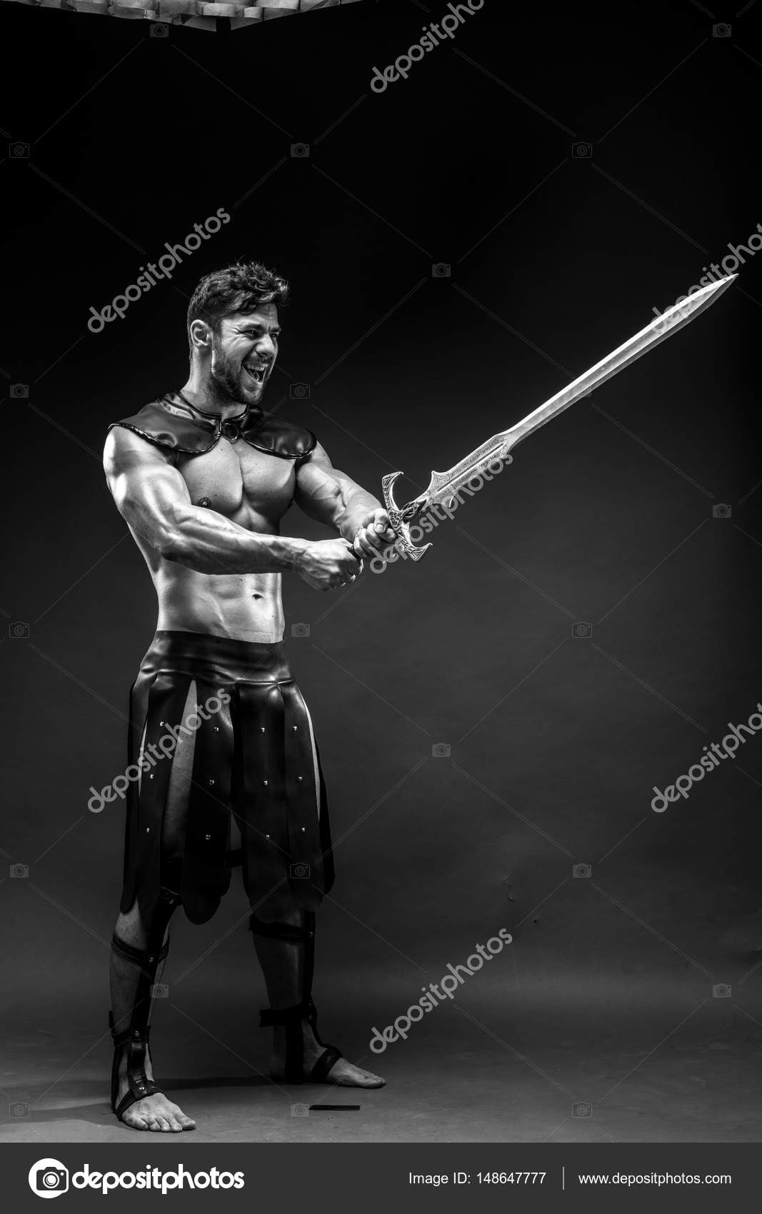 Severe barbarian in leather costume with sword u2014 Stock Photo  sc 1 st  Depositphotos : leather gladiator costume  - Germanpascual.Com