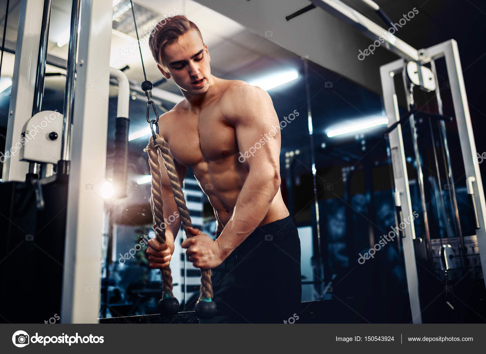 Handsome Muscular Fitness Bodybuilder Doing Heavy Weight Exercise For Triceps Stock Photo