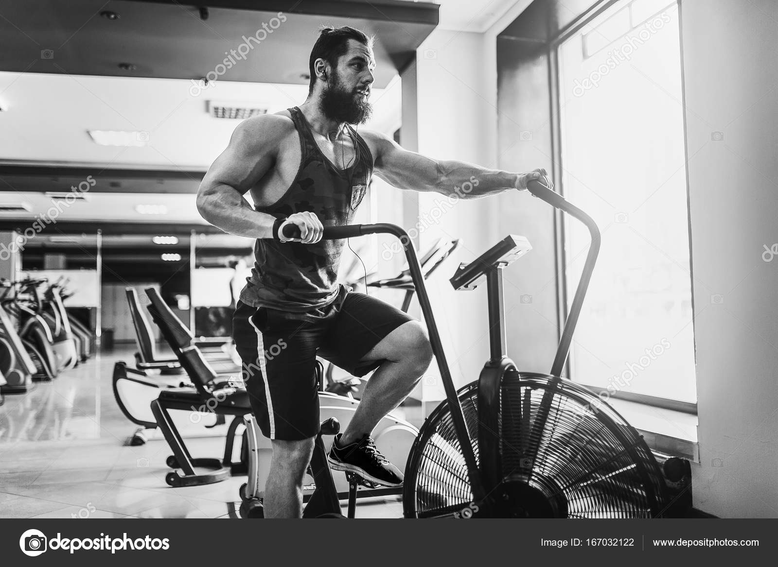 Man Using Exercise Bike At The Gym Fitness Male Air For Cardio Workout Functional Training Photo By Zamuruev
