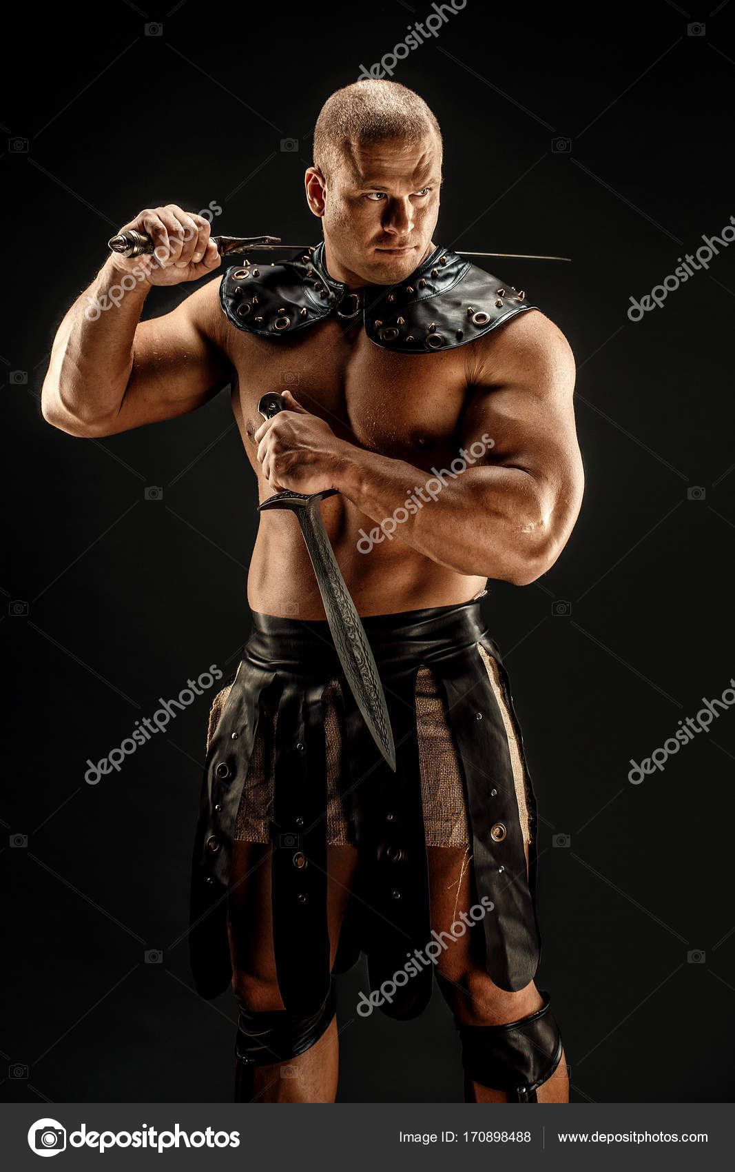 Severe barbarian in leather costume with two swords. Portrait of balded muscular gladiator. Studio shot. Black background. u2014 Photo by zamuruev : leather gladiator costume  - Germanpascual.Com