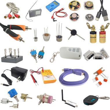 Digital  multimeter, cable and radio components on white