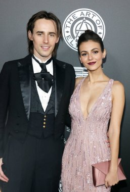 Victoria Justice and Reeve Carney at the Art Of Elysium's 11th Annual Heaven Celebration held at the Barker Hangar in Santa Monica, USA on January 6, 2018.