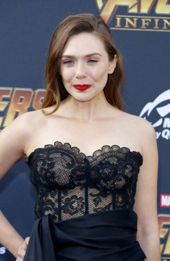 actress Elizabeth Olsen at the premiere of Disney and Marvel's 'Avengers: Infinity War' held at the El Capitan Theatre in Hollywood, USA on April 23, 2018.